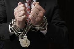Hombre de negocios en cadenas Imagen de archivo libre de regalías