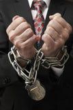 Hombre de negocios en cadenas Imagenes de archivo