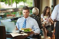 Hombre de negocios en café Imagenes de archivo