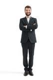 Hombre de negocios en desgaste formal con las manos dobladas Imagen de archivo