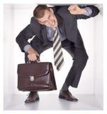 Hombre de negocios en el cubo Fotos de archivo