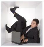 Hombre de negocios en el cubo Fotografía de archivo libre de regalías