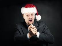 Hombre de negocios en el sombrero de Santa Concepto de la Navidad y del Año Nuevo humor Fotos de archivo libres de regalías