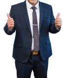 Hombre de negocios en el traje azul que muestra como los fingeres en un backgro blanco Imagen de archivo