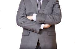 Hombre de negocios en el traje gris aislado en blanco Fotografía de archivo