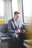 Hombre de negocios en el tren Foto de archivo libre de regalías