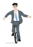 Hombre de negocios en el unicycle Imagen de archivo libre de regalías