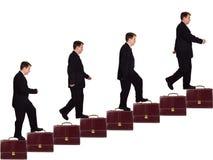 Hombre de negocios en escalera de la carrera Foto de archivo