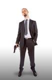 Hombre de negocios en esposas con la pistola a disposición Fotos de archivo libres de regalías