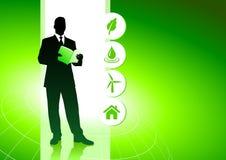 Hombre de negocios en fondo verde del ambiente Imágenes de archivo libres de regalías