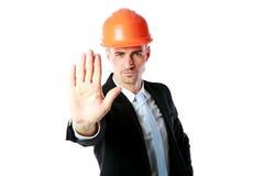 Hombre de negocios en gesto de la parada de la demostración del casco imágenes de archivo libres de regalías