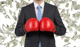 Hombre de negocios en guantes de boxeo Imagenes de archivo