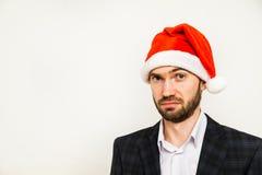 Hombre de negocios en juego con el sombrero de santa en la pista Aislado sobre el fondo blanco Fotografía de archivo