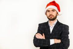Hombre de negocios en juego con el sombrero de santa en la pista Aislado sobre el fondo blanco Fotos de archivo libres de regalías
