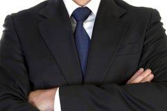 Hombre de negocios en juego con los brazos cruzados Foto de archivo libre de regalías
