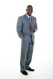 Hombre de negocios en juego gris foto de archivo