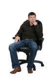 Hombre de negocios en la butaca Imagen de archivo libre de regalías