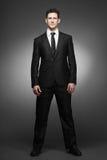 Hombre de negocios en la camisa blanca y el juego negro. Foto de archivo libre de regalías