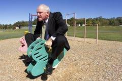 Hombre de negocios en la competencia infantil Imagen de archivo libre de regalías