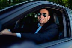 Hombre de negocios en la conducción de automóviles Imágenes de archivo libres de regalías