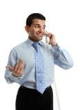 Hombre de negocios en la discusión sobre el teléfono Imágenes de archivo libres de regalías