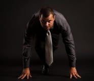 Hombre de negocios en la posición de salida Imagen de archivo libre de regalías