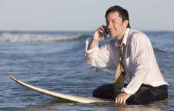 Hombre de negocios en la tabla hawaiana Fotografía de archivo