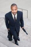 Hombre de negocios en las escaleras foto de archivo libre de regalías