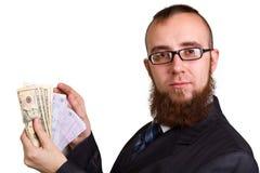 Hombre de negocios en los vidrios que llevan a cabo dólares Imágenes de archivo libres de regalías