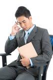 Hombre de negocios en silla Imagen de archivo libre de regalías
