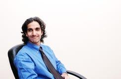 Hombre de negocios en su silla imagen de archivo