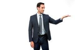 Hombre de negocios en traje con el brazo levantado Fotografía de archivo libre de regalías