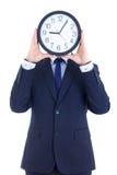 Hombre de negocios en traje con la cara de la cubierta del reloj aislada en blanco Fotos de archivo libres de regalías
