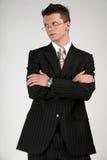 Hombre de negocios en un juego negro. Imagenes de archivo