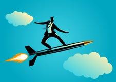 Hombre de negocios en una pluma del cohete Fotografía de archivo libre de regalías