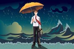 Hombre de negocios en una tormenta Imagen de archivo
