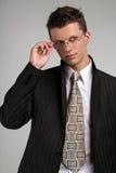 Hombre de negocios en vidrios Imágenes de archivo libres de regalías