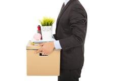 Hombre de negocios encendido que lleva sus pertenencia fotografía de archivo libre de regalías