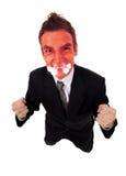 Hombre de negocios enojado con la cara de estallido roja Imagen de archivo