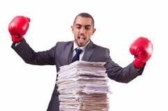 Hombre de negocios enojado con la pila Imagen de archivo