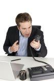 Hombre de negocios enojado en el teléfono Fotos de archivo