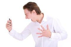 Hombre de negocios enojado en el teléfono Foto de archivo