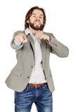 Hombre de negocios enojado que gesticula un movimiento del corte en la garganta, que co Fotografía de archivo libre de regalías