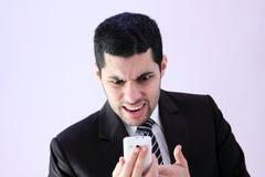 Hombre de negocios enojado que grita Imagen de archivo