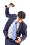 Hombre de negocios enojado que lanza su teléfono móvil Imagen de archivo