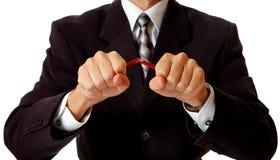 Hombre de negocios enojado que rompe el lápiz Foto de archivo libre de regalías