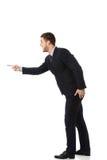 Hombre de negocios enojado que señala a la izquierda Imagen de archivo libre de regalías