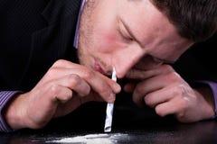 Hombre de negocios enviciado a las drogas imágenes de archivo libres de regalías