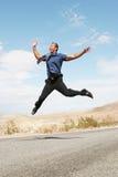 Hombre de negocios extático que salta en el aire Imagen de archivo