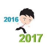 Hombre de negocios feliz al funcionamiento a partir de 2016 a 2017, concepto del éxito del Año Nuevo, presentado en forma Fotografía de archivo libre de regalías